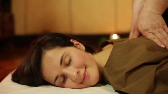 Thumbnail for Girl Brunette Lying On a Massage Table And Relaxes