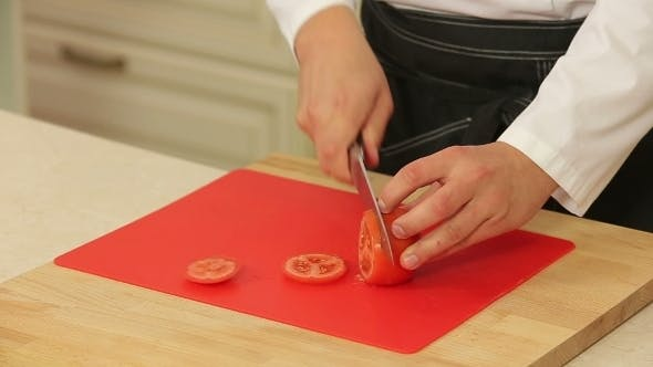 Thumbnail for Chef Slicing Tomato On Cutting Board