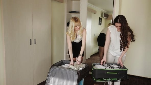 Thumbnail for Blonde And Brunette Stealing Things Into a Suitcase