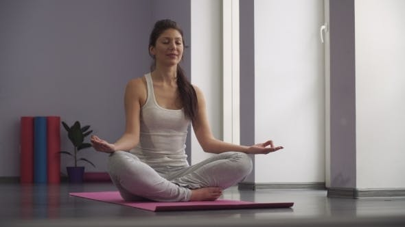 Thumbnail for Yoga Girl Meditating And Making a Zen Symbol With Her Hand
