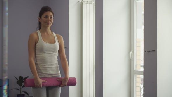 Girl Turns Yoga Mat