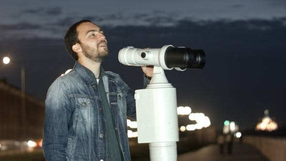 Thumbnail for Man Using a Coin Operated Telescope Enjoying a Great View Of The City