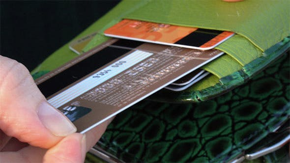 Cover Image for Woman is Choosing Plastic Card
