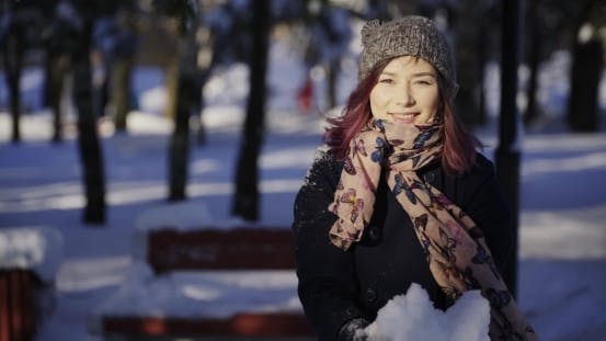 Thumbnail for Girl Throws Snow Up At Sunny Day