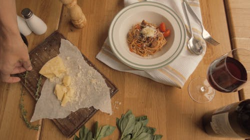 Serving Pasta Bolognese with Parmesan and Thyme