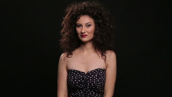Thumbnail for Young Brunette With Long Brown Curly Hair Dancing