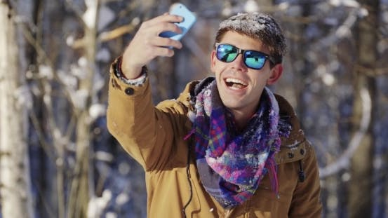Thumbnail for Happy Man Making a Selfie In Winter Park