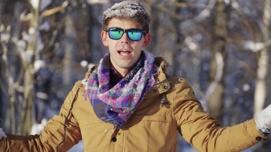 Thumbnail for Cheerful Man Throws Snow Up
