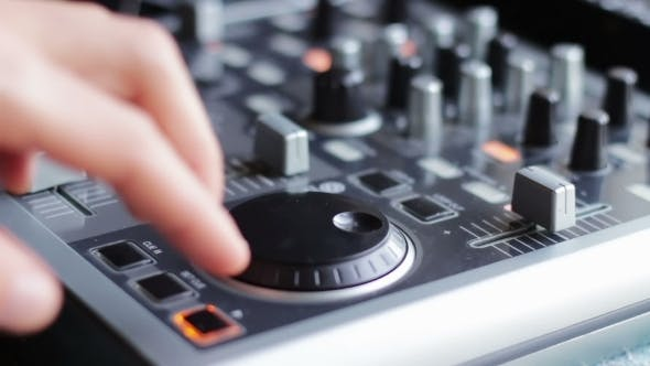 Thumbnail for DJ Working With Sound Mixing Console