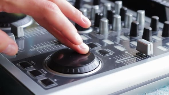 Thumbnail for DJ Working With Sound Mixing Console.