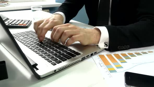 Thumbnail for Business People Typing on a Laptop Computer in the Office