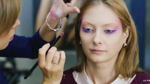 Beauty Saloon. Women Apply Make-up