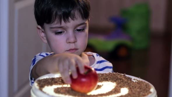 Thumbnail for Cheerful Boy Playing With  Red Apples.