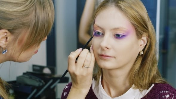 Thumbnail for An Attractive Girl Doing Makeup