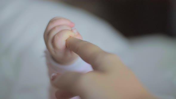 Thumbnail for Baby Daughter Holding Mum Finger