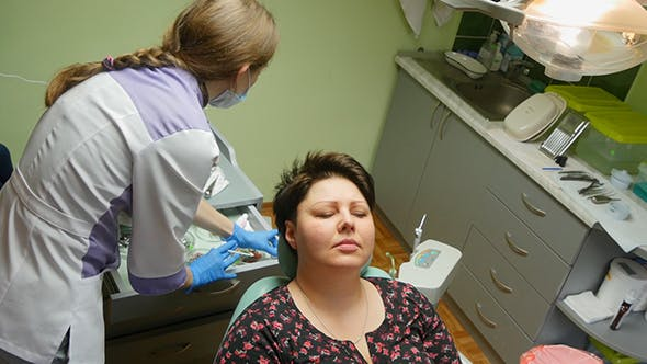 Thumbnail for Dentist Examining Patient Teeth