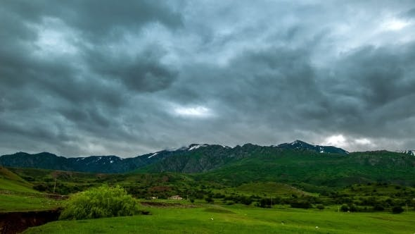 Cover Image for Storm Clouds Over The Mountains