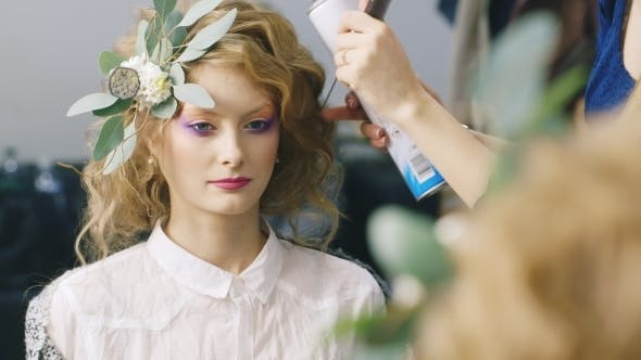 Thumbnail for Beautiful Woman Doing An Unusual Hairstyle With Fresh Flowers