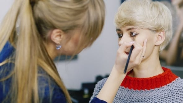 Cover Image for An Attractive Woman With a Short Haircut Applied Makeup