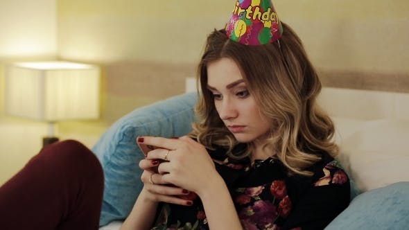 Thumbnail for Sad Birthday Girl Writes The Message On Your Smartphone