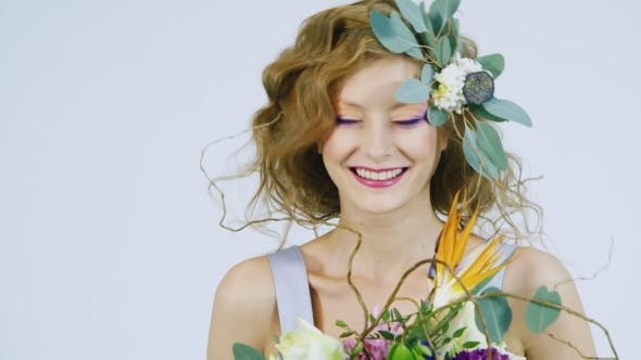 Cover Image for Portrait Of a Young Woman Holding Flowers In Her Hair