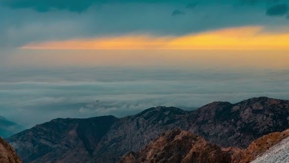 Cover Image for Clouds Float In Bottom Of The Mountains At Sunset
