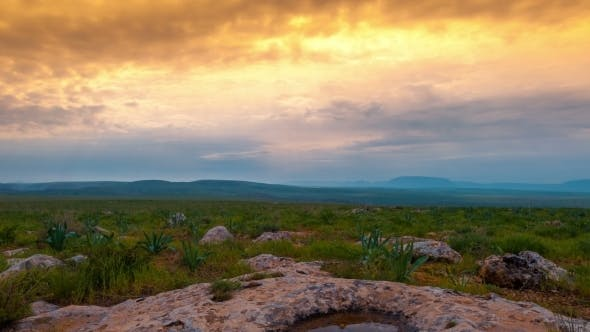 Cover Image for Dramatic Sunset In a Rocky Steppe With Beautiful Green Grass