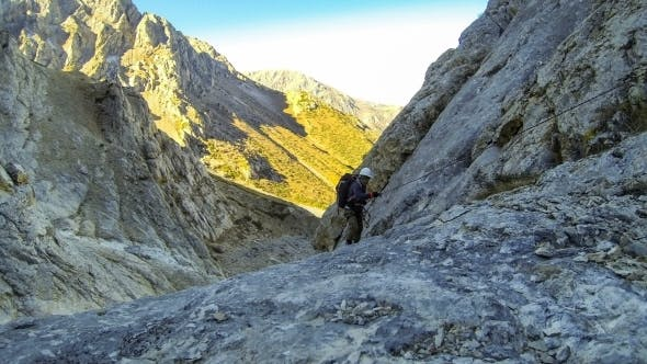 Cover Image for Climber Climbs Up The Rope To The Rock