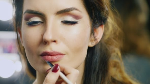 Cover Image for Young Woman Doing Makeup