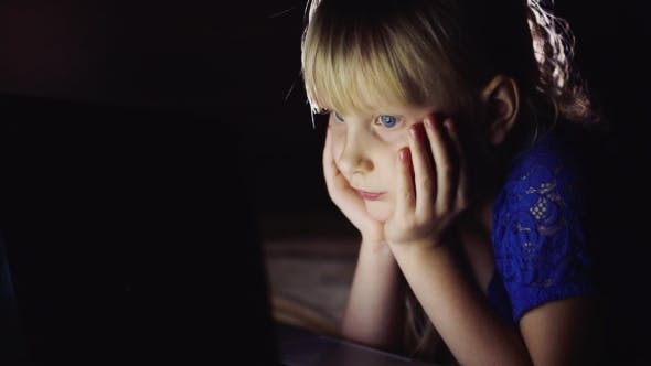 Cover Image for The Blue-eyed Child Looking At The Laptop Screen