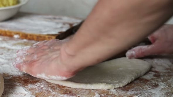 Thumbnail for Woman Rolls The Dough With a Rolling Pin