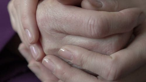 Comforting Wrinkled Hands: Grandmother And Granddaughter