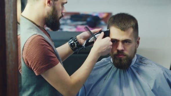 Thumbnail for Male Barber At Work, Doing Hairstyle Young Man