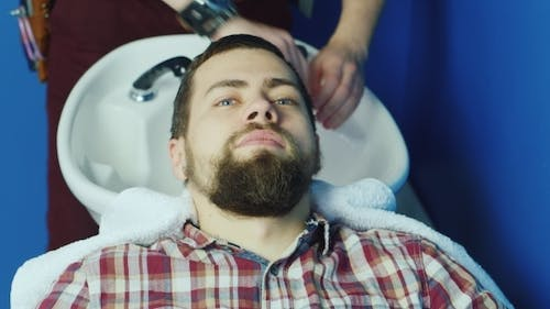 Attractive Man Washed His Head At Hairdresser