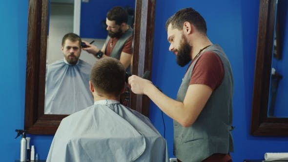 Thumbnail for Friendly Barber Dries The Hair Dryer To The Client
