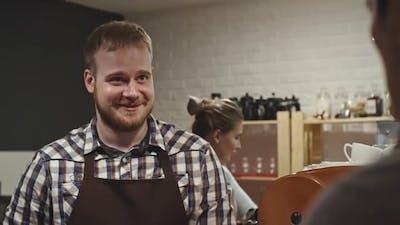 Barista Giving Coffee to Customer