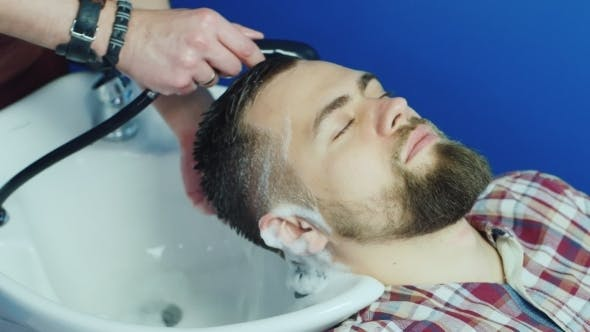 Thumbnail for Man Barber Washing Male Hair In a Barbershop