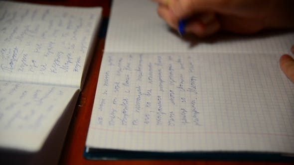 Thumbnail for Boy Writes In Notebook Homework On Russian Language