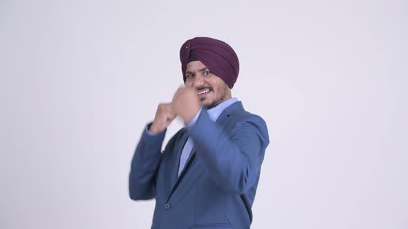 Thumbnail for Happy Bearded Indian Sikh Businessman in Fighting Stance