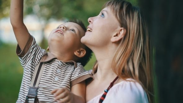 Thumbnail for Mother With a Child Look At The Sky