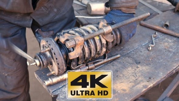 Thumbnail for Auto Mechanic Working On Shock Absorber In Garage