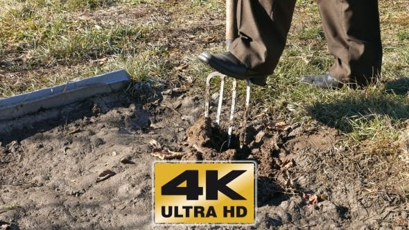 Thumbnail for Digging Spring Earth Soil In Garden With Pitchfork