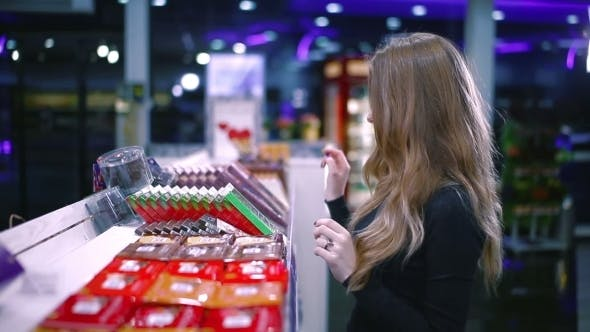Thumbnail for Girl Choosing Products on The Shelf in The Market