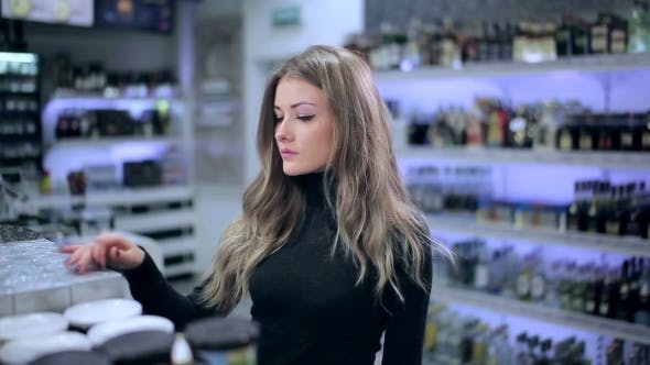 Thumbnail for Girl Looks At Products From The Shelf In Store