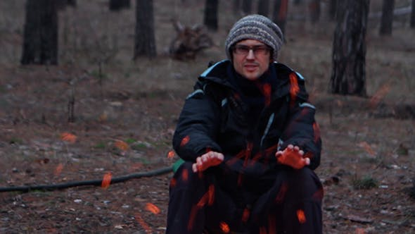 Thumbnail for Man Is Heated By The Fire