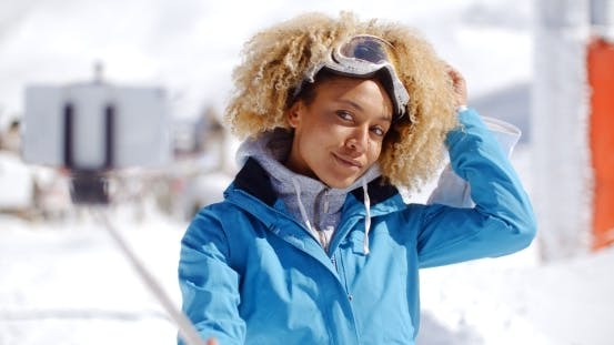 Thumbnail for Attractive Young Woman With a Modern Afro Hairdo