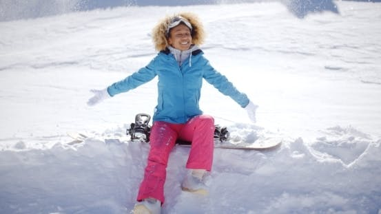 Thumbnail for Beautiful Young Snowboarder Sitting On Snow