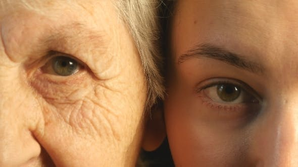 Thumbnail for Old And Young Eye - Grandmother And Granddaughter Looking Together At Camera