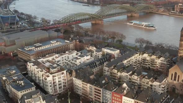 Thumbnail for AERIAL: Over Cologne Old Town and View on Rhine and Hohenzollern Bridge with Train Crossing and Boat