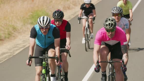 Group of cyclists on road.  Fully released for commercial use.